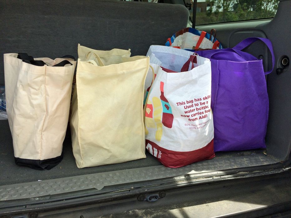 bags of groceries in back of SUV