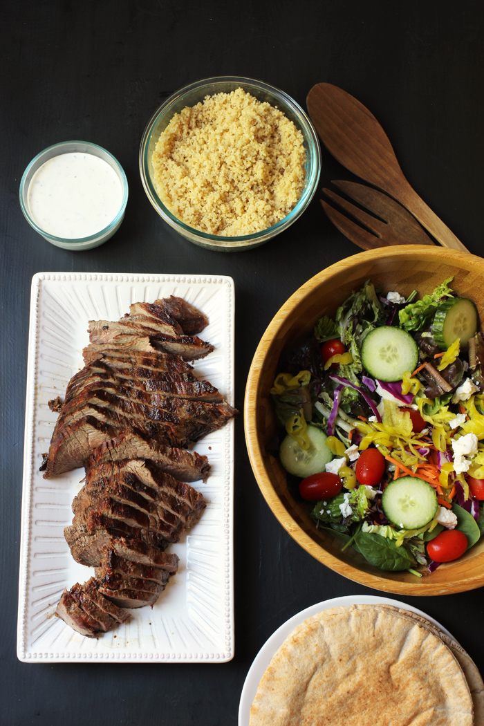 grilled steak with salad and pita