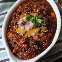 A bowl of quinoa chili with toppings