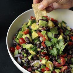 bowl of bean and avocado salsa with chips