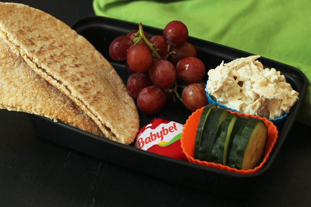 Tuna Pita pocket packed for lunch with fruit and cheese