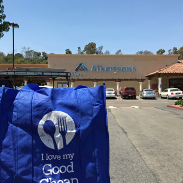 Good Cheap Eats grocery bag in front of Albertsons