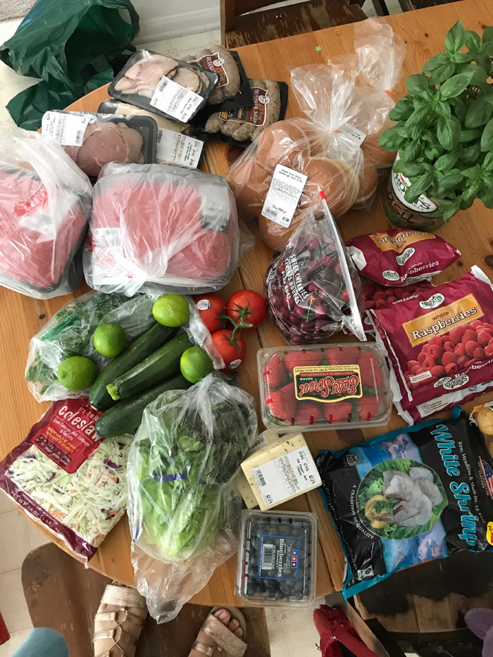 groceries scattered on kitchen table