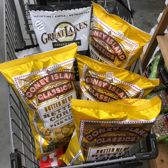 bags of clearance popcorn in grocery cart