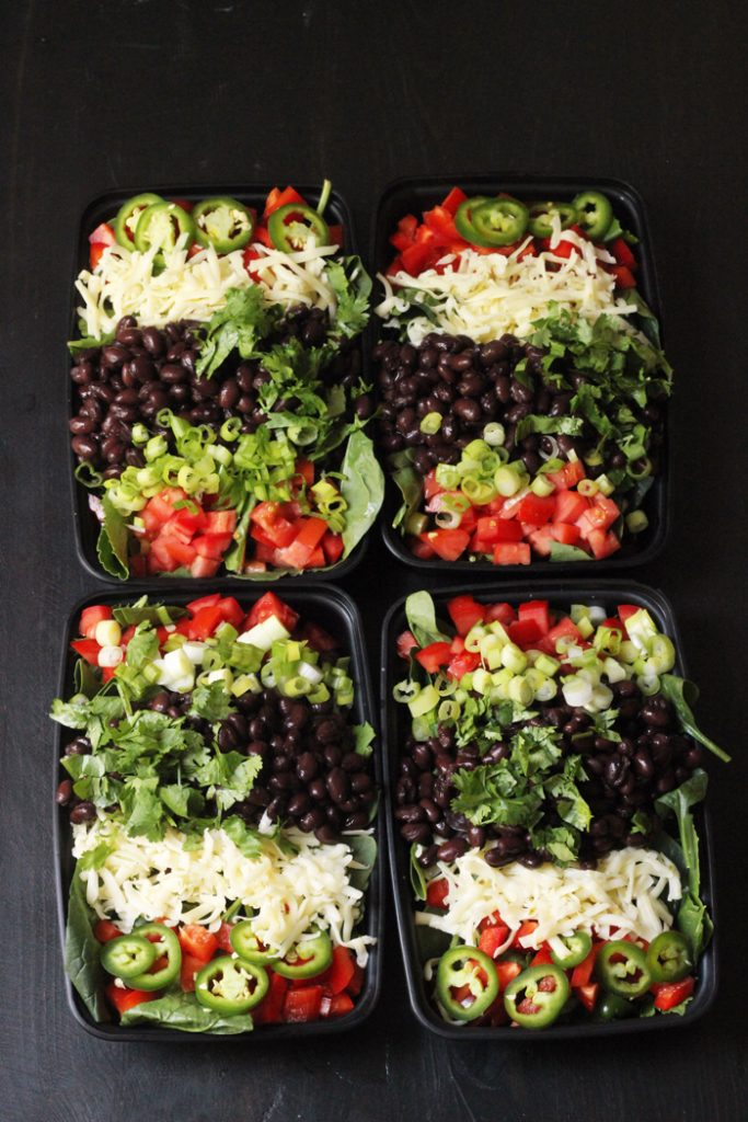four black bean salads in to go containers