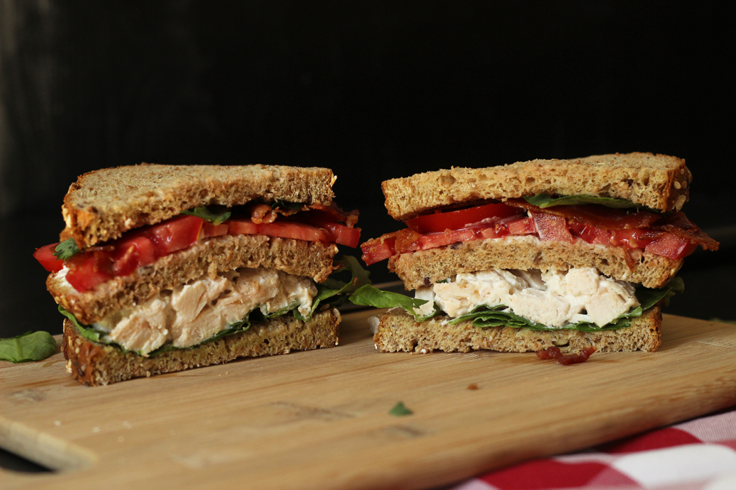 chicken salad club sandwich cut in half