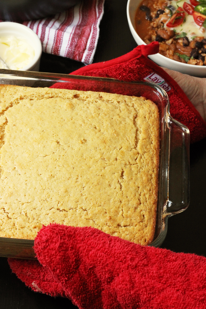 A close up of pan of cornbread on a table