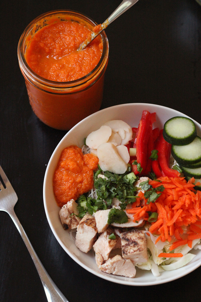 asian bowl with a mason jar of carrot ginger dressing