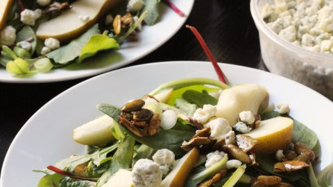 two plates of pear and blue cheese salad