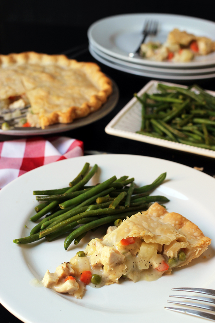 plate of chicken pot pie and green beans on set table