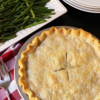 pot pie next to plate of green beans