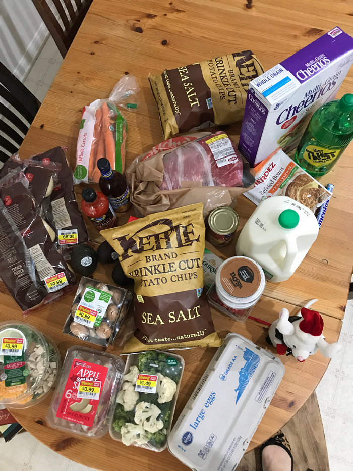 A bunch of grocery items that are sitting on a table