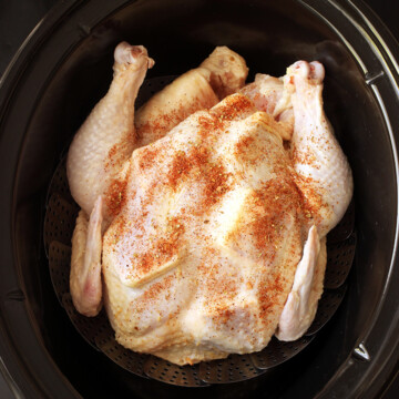 prepped chicken on steamer in slow cooker