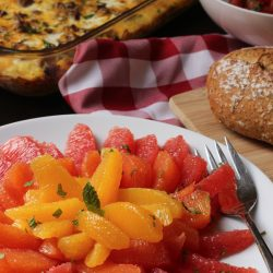citrus salad, bread, and breakfast casserole