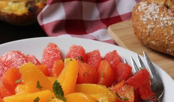 citrus salad, bread, and breakfast casserole