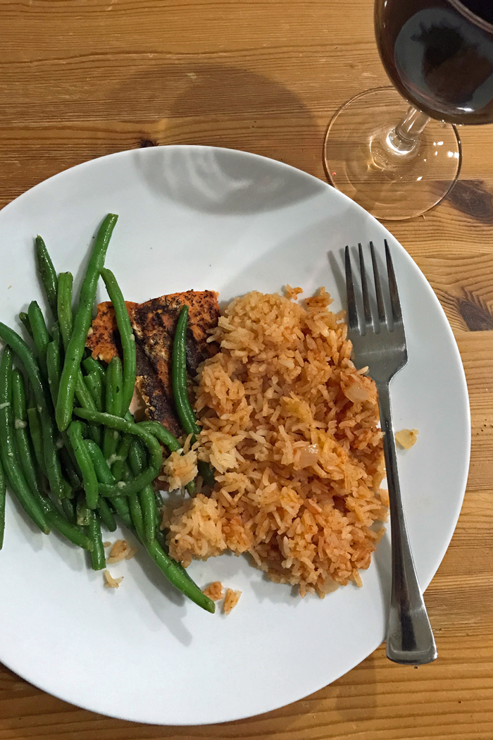 grilled fish, rice and green beans on a plate
