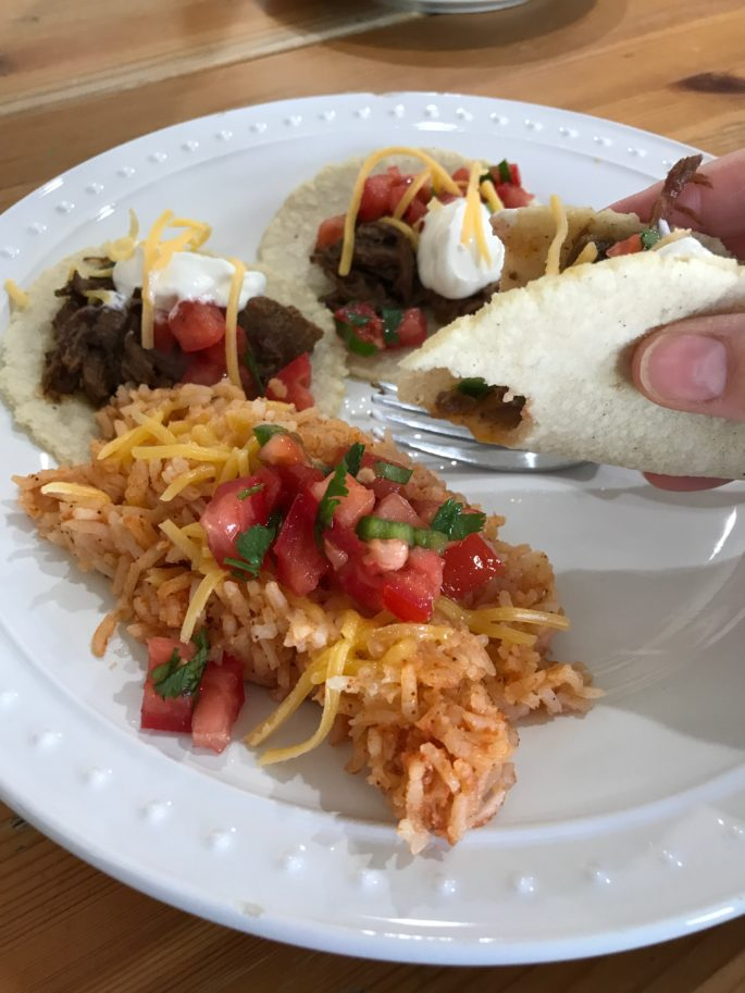 tacos and rice on a plate