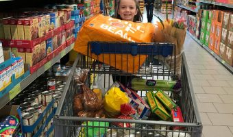girl pushing aldi shopping cart