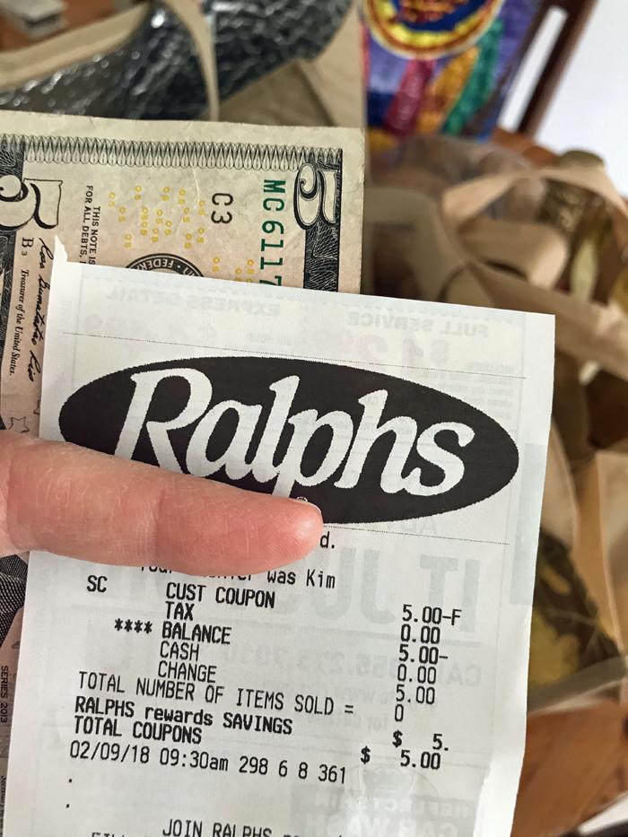 ralphs receipt with five dollar bill