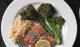 A plate of food with broccoli and Salmon