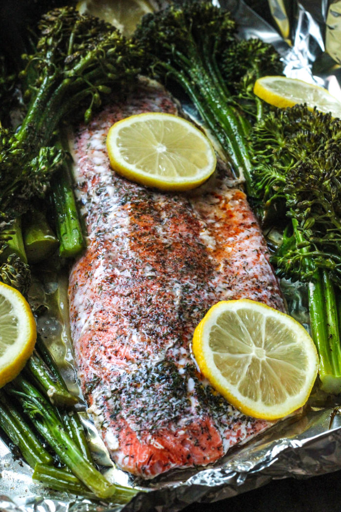 salmon on foil with lemon and broccolini