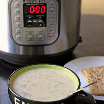 bowl of broccoli soup next to pressure cooker