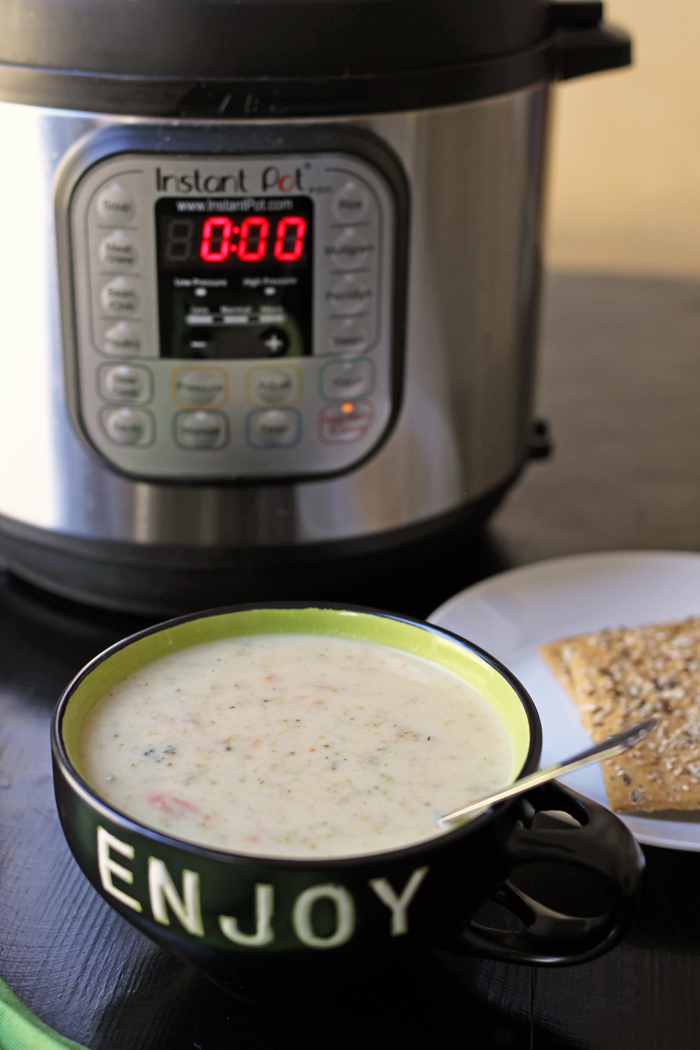 bowl of broccoli cheese soup and an instant pot