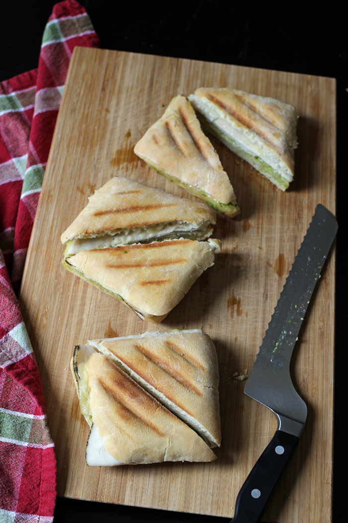 Turkey Pesto Panini on a cutting board