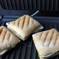 turkey sandwiches with grill marks on the panini press