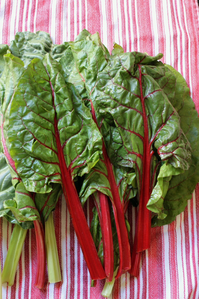 A table topped with swiss chard