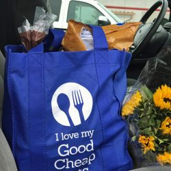 grocery bag and flowers on front seat of car