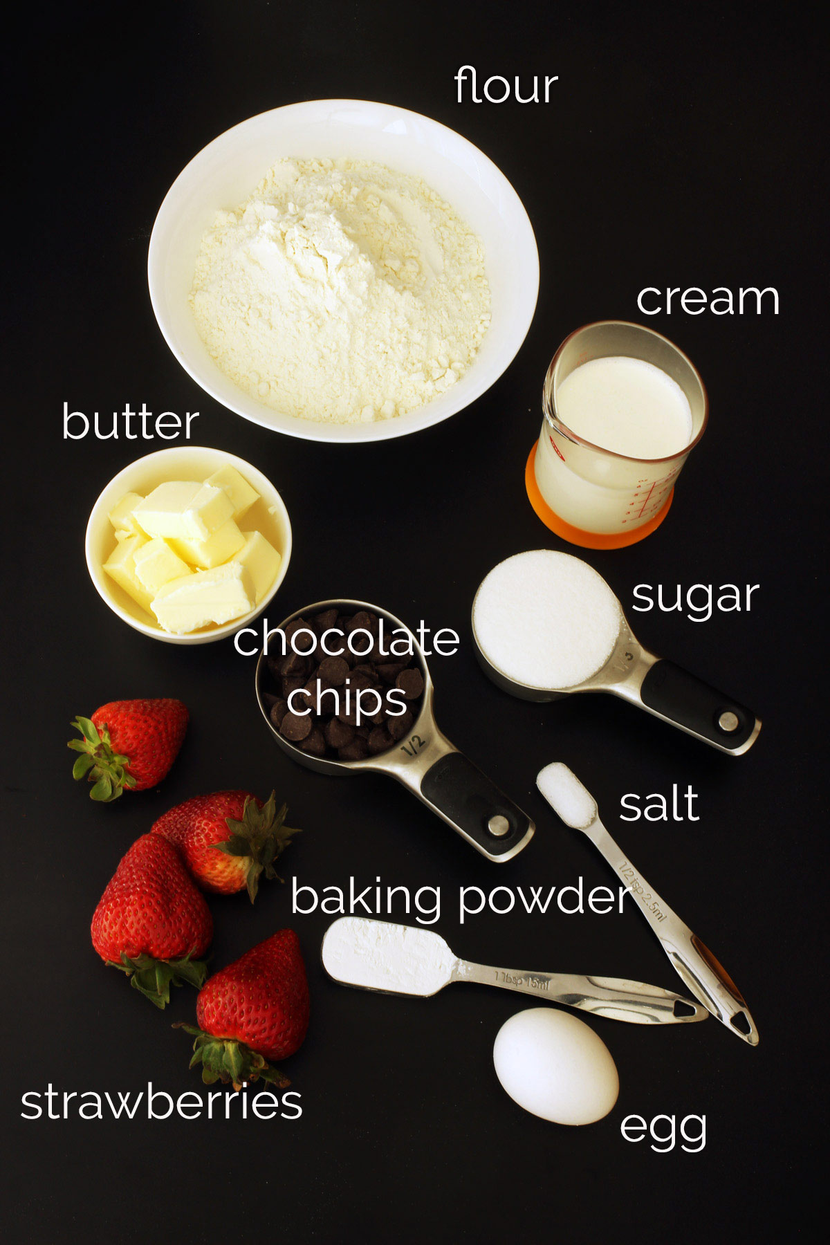 ingredients for Chocolate Strawberry Scones on table top.