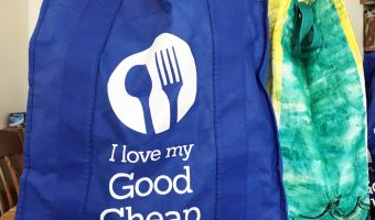 A blue and white grocery bag that says I love my Good Cheap Eats