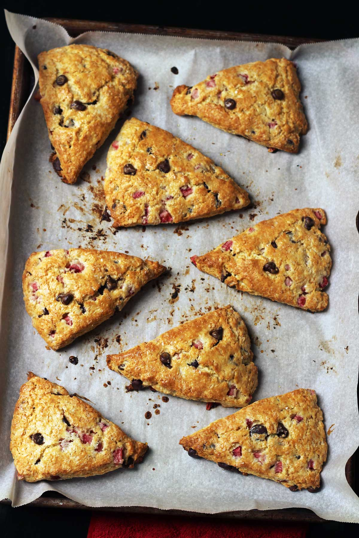baked chocolate strawberry scones on parchment lined tray.