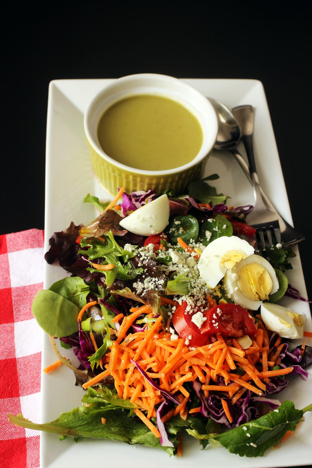 cup of asparagus soup on salad platter