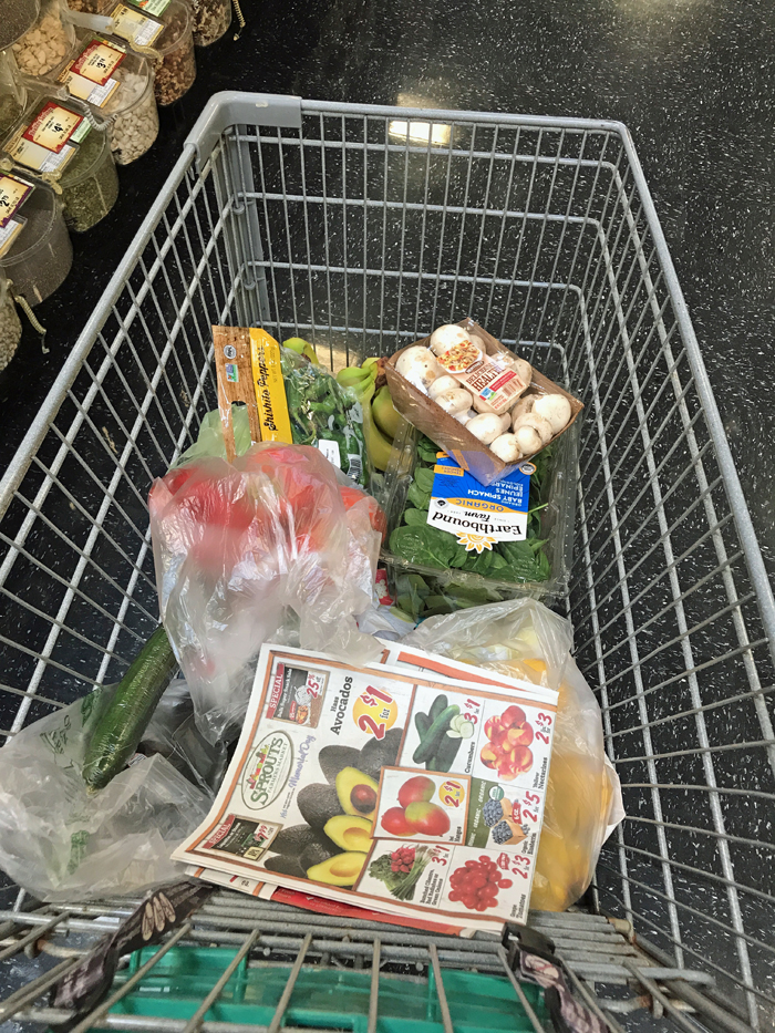 A cart of food with sprouts ad