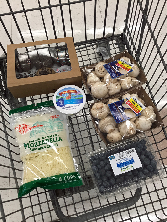 mushrooms and other groceries in cart