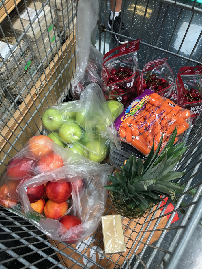 grocery cart full of fresh fruit and vegetables
