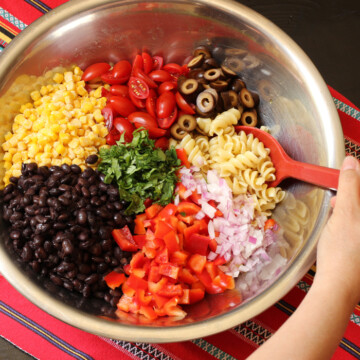 A bowl of ingredients for southwest pasta salad