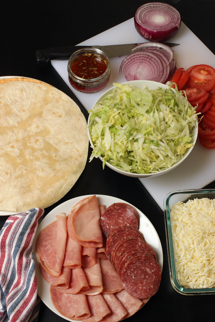 ingredients for italian wraps laid out on table