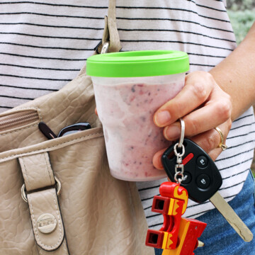 woman holding keys and frozen smoothie