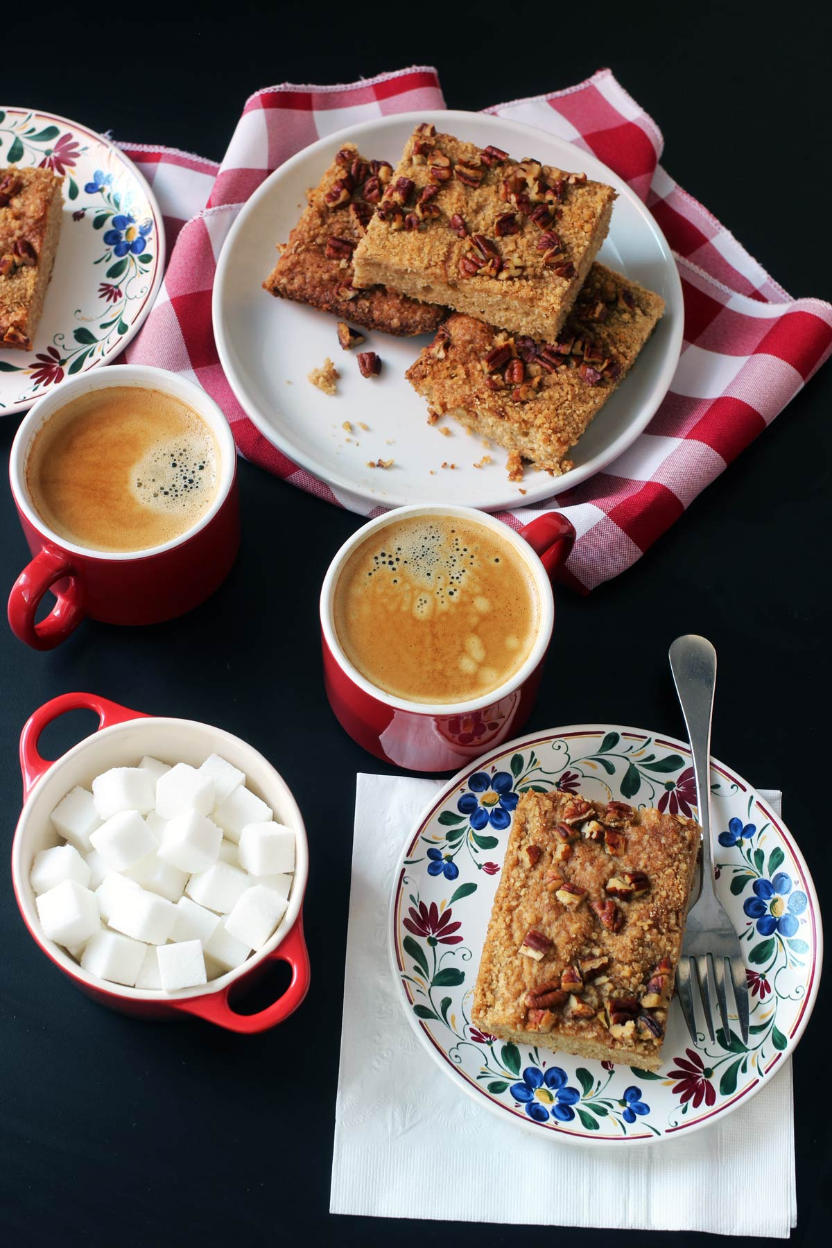 banana coffeecake on table with coffee