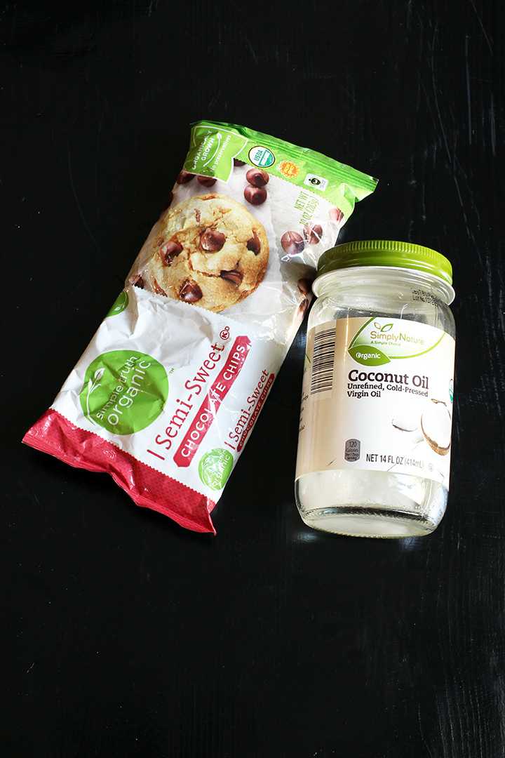 bag of chocolate chips and jar of coconut oil on table