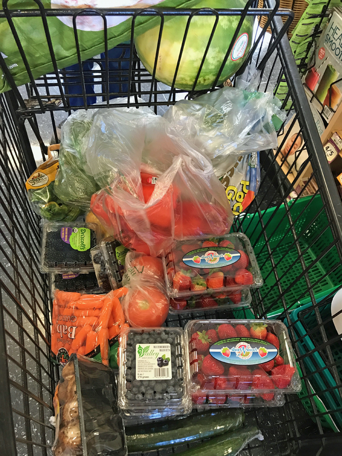 strawberries and other groceries in cart
