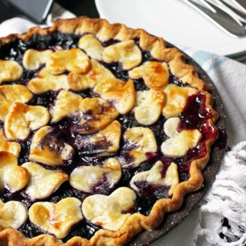 whole baked blueberry pie on cloth