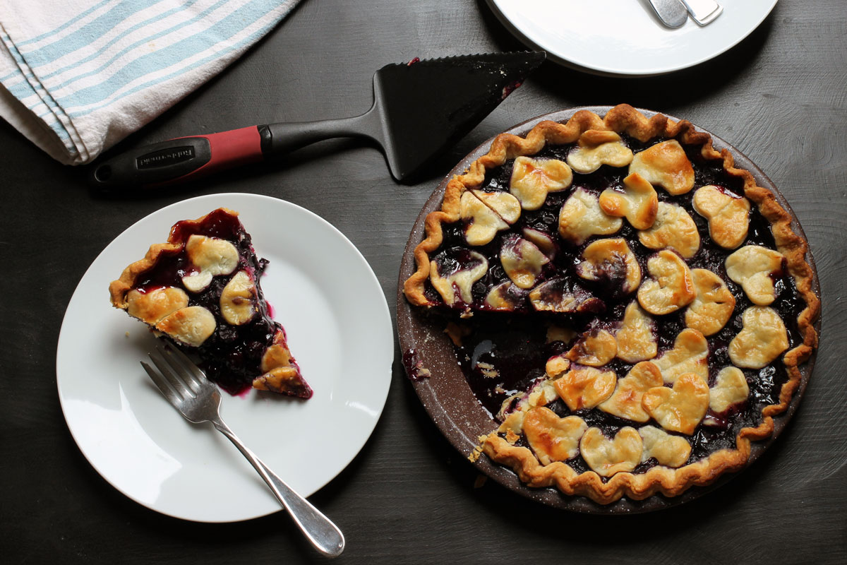 blueberry pie and slice on table