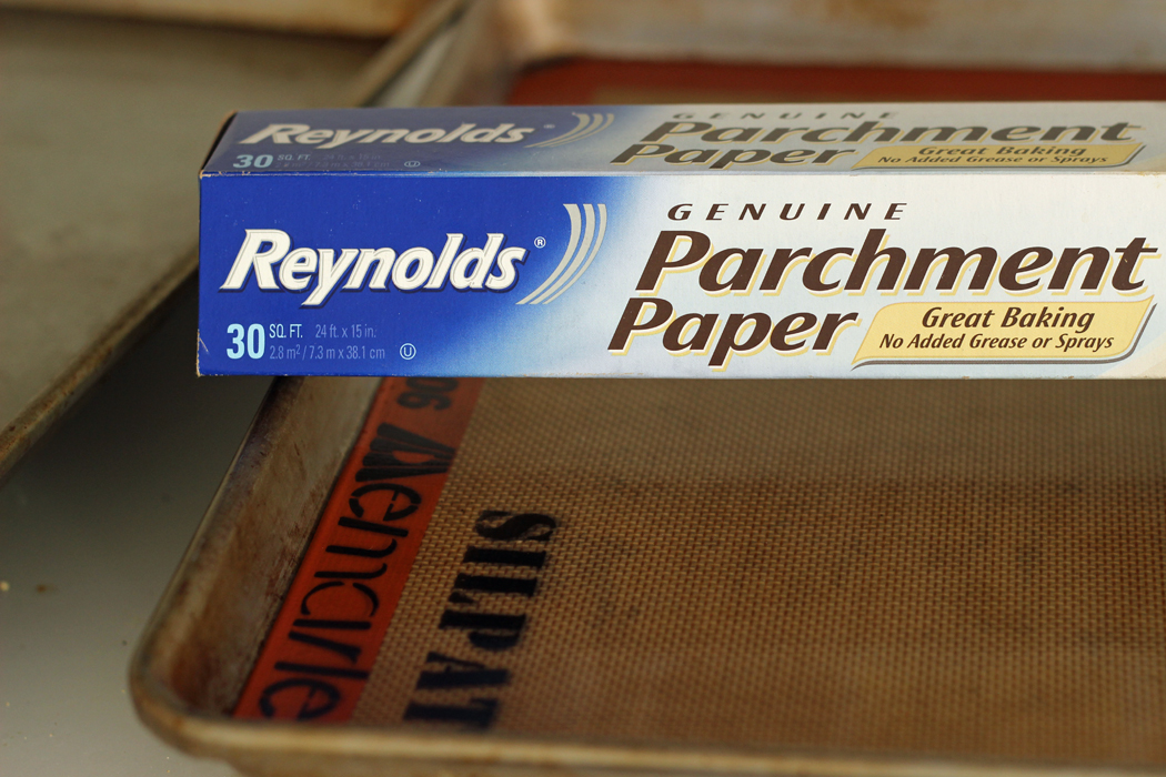 box of parchment paper and silpat mat