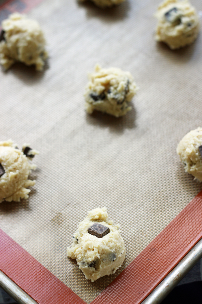 cookie dough balls with chocolate chunks on silpat mat
