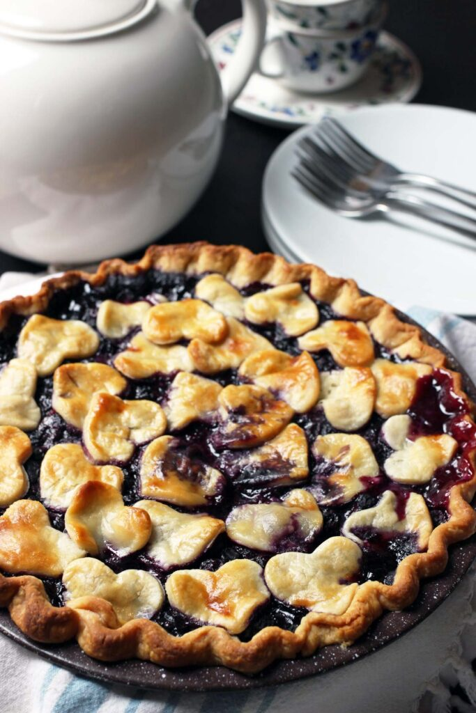 whole blueberry pie on table