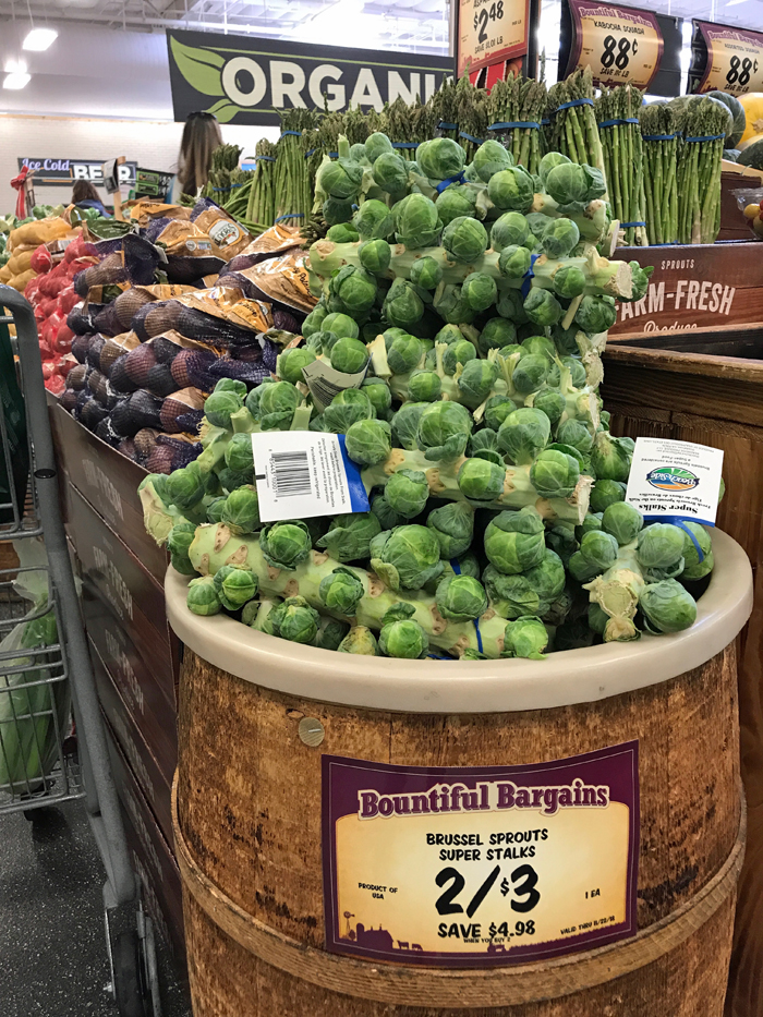 barrel of Brussels sprout in produce department